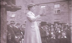 A suffragette, believed to be Adela Pankhurst - daughter of Emmeline - at an open-air meeting in Perth in 1908.