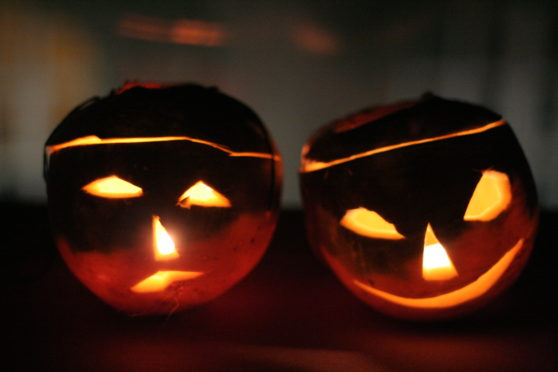Traditional carved turnips are lit up to scare off spectres