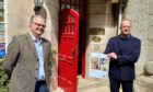 Knockomie Inn owner Gavin Ellis (left) and Stewart Marshall, of Johnstons of Elgin, at the Forres Inn with one of the prototype posters.