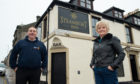 4th Lossiemouth Company Boys' Brigade captain James Allan and Steamboat Inn owner Hazel Istance at the Steamboat Inn pub - who has given the group temporary facilities for free.  Picture by Jason Hedges.