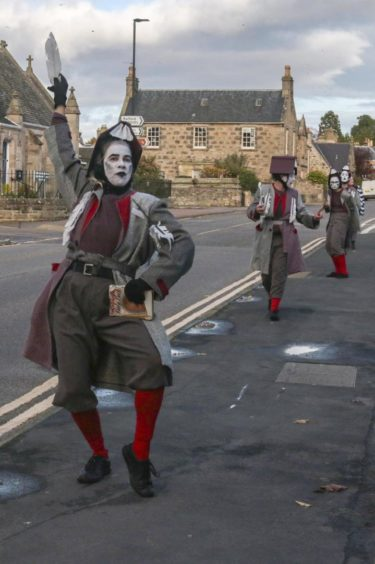 The cast of librarians toured the centre of Forres.