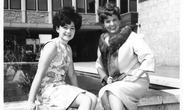 Coronation Street stars Jennifer Moss, left, who played Lucille Hewitt, alongside Pat Phoenix, who played Elsie Tanner, outside Grampian TV, Queen's Cross in 1963.