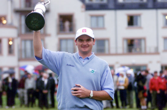Scotland's Paul Lawrie holds the Claret Jug aloft after winning the 1999 Open Championship at Carnoustie, Scotland,  after a play-off with Justin Leonard and Jean Van De Velde.