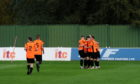 Rothes' players celebrating after making it 2-1 in extra-time against Formartine at North Lodge Park.  Picture by Darrell Benns