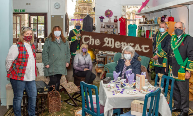 Pictured at The Mercat are Liz Wilson (volunteer with Retro Rooms) Maggie Driver (Proprietor of Mercat) Eric MacGregor (Provinchial Grand Master of Banffshire) Pauline Miller (artist/crafter) George Wilson (substitute Grand Master of Banffshire) Liz Lyall (Pict Design) Neil Stephen (Deputy Provinchial Grand Master of Banffshire).