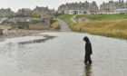 Waves caused flooding at the car park at Lossiemouth's West Beach.