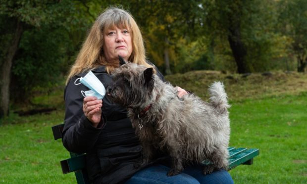 Linda Harper is highlighting the dangers to animals of discarded disposable face masks after her cairn terrier, Malcolm, ate one. Pictures by Jason Hedges.