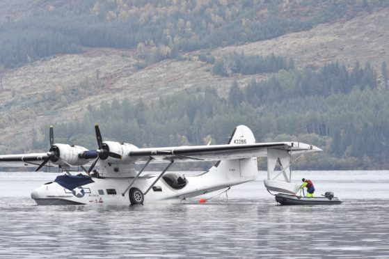 A seaplane is removed from Loch Ness by crane. Pictures by Jason Hedges.