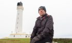 Chairman Chris Tuke outside the Covesea Lighthouse. Pictures by Jason Hedges.