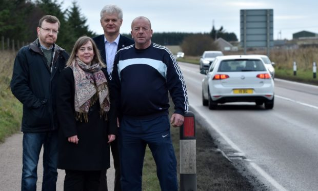 Stephen Smith, Lisa Buchan, Alan Fakley and Bruce Buchan, all of the Dual Peterhead group, on the A90 as it comes into Peterhead.  Picture by Kenny Elrick.