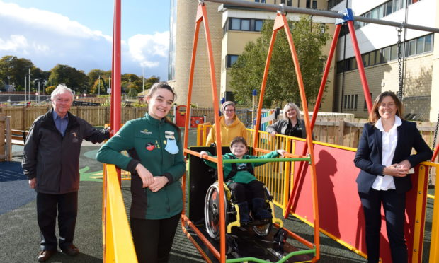 Joe Mackie, chairman of Archie Foundation, Victoria Alexander from Morrisons, frequent playground user Baxter on the swing with his mum Ailsa Dick, Sarah Brown from Morrisons and Paula Cormack, director of fundraising at Archie Foundation.