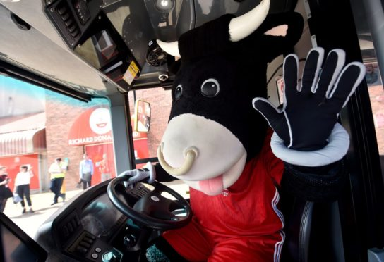 Angus the Bull on a First Bus outside Pittodrie Stadium.