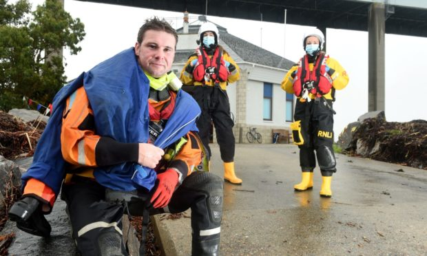 Rob Fielder is welcomed home by crew at North Kessock Lifeboat Station after his final five plus miles of his virtual run from North Kessock to the RNLI Headquarters in Poole to raise funds for the station. Picture by Sandy McCook