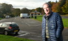 Councillor Gordon Adam of Highland Council at the  North Kessock car park on the A9 where the council intend to install 30 'aire' spaces for motorhomes and caravans.