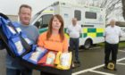 Gordon and Sandra McKandie with one of the four paramedic kits. Picture by Sandy McCook.