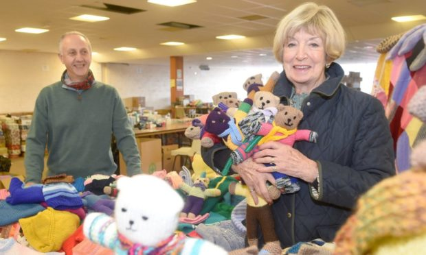 Danny Muschate of Blythswood with club president, Sandra Clarkson and some of the knitted goods.