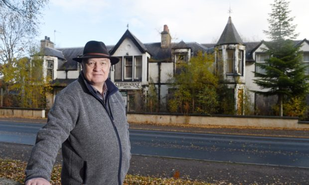 Councillor Bill Lobban outside the former Struan House Hotel in Carrbridge