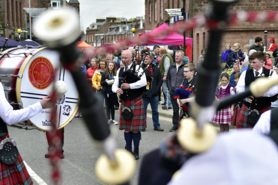 Turriff and District Pipe Band plays at a previous town centre engagement.