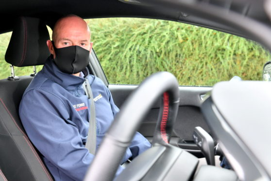 Mintlaw driving instructor Mike Ferris is among several local businesses to have received funding from the community council to accomodate extra PPE costs.