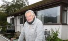 Roddy Macleod outside his home at Inverinate