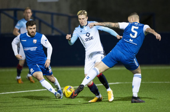 Oli Shaw, centre, in action for Ross County against Montrose