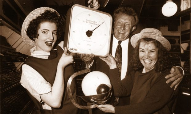 "Football legend Denis Law gave fruit and veg girls Kelly Coutts, left, and Jenny Lawrie a surprise when he ""weighed in"" with some tips on ball control at the opening on Norco's superstore at Berryden in 1991."