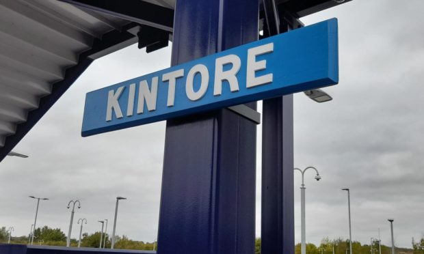The original Kintore Railway Station sign, refurbished and installed at the brand new station.