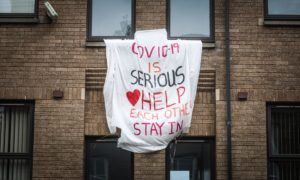 STAY SAFE: A banner encouraging people to stay in their homes during the early weeks of the Covid-19 crisis.