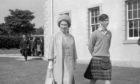 Queen Elizabeth II, at Gordonstoun School with Prince Charles