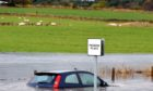 Heavy rain could cause flooding on roads.
