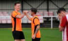 Craig Cormack, left, and team mate Alasdair Stark celebrate Rothes' Highland League Cup semi-final victory. Picture by Darrell Benns