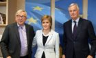 Scotland's First Minister Nicola Sturgeon poses with European Commission President Jean-Claude Juncker, left, and European Union chief Brexit negotiator Michel Barnier