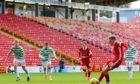Aberdeen midfielder Lewis Ferguson scores to make it 3-3 in the game against Celtic.