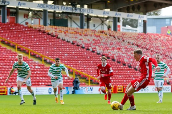 Aberdeen midfielder Lewis Ferguson scores to make it 3-3 in the game against Celtic.