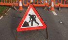 A generic image of a road closed by roadworks