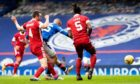 Kemar Roofe scores Rangers' second against Aberdeen on Sunday.