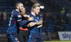 Oli Shaw celebrates scoring for Ross County.