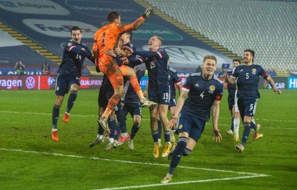 David Marshall is held aloft after saving Aleksandar Mitrovic's penalty.