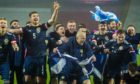 Scotland's players celebrate taking their place at Euro 2020.