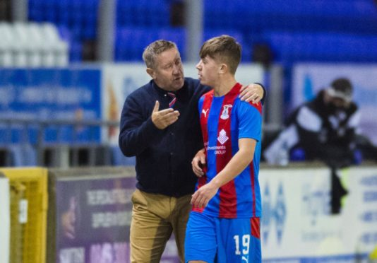Inverness manager John Robertson with midfielder Kai Kennedy during a Betfred Cup match between Inverness Caledonian Thistle and East Fife.