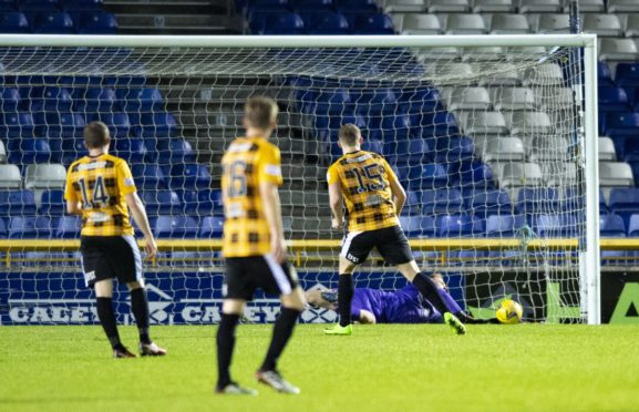 Inverness keeper Cameron Mackay saves a penalty from East Fife's Jack Hamilton.