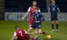 Adam MacKinnon in action for Ross County.