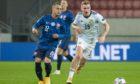 Scotland's Oli McBurnie (R) closes down Slovakia's Stanislav Lobotsky.