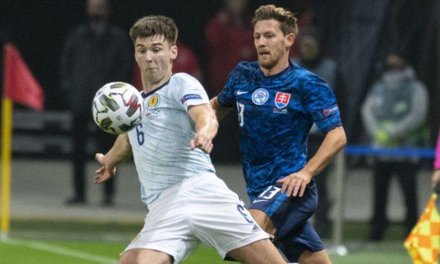 Scotland's Kieran Tierney (L) is closed down by Slovakia's Patrik Hrosovsky.