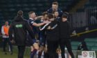 Ross County players celebrate after winning against Celtic at Parkhead.