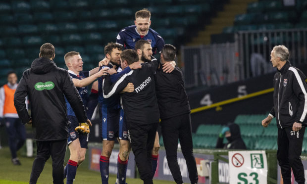 Ross County players and staff celebrate the victory at Parkhead.