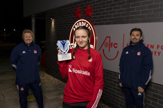 Bayley Hutchison with the SWPL player of the month award for October. Pictured with Aberdeen FC Women coaches Emma Hunter and Stuart Bathgate.