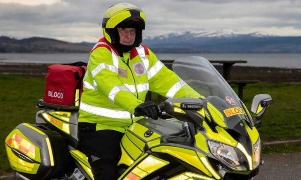 Highland and Islands Blood Bikes President Ross Sharp on one of the Blood Bikes.