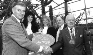 Holywood legend Charlton Heston congratulates Aberdeen Lord Provost Henry Rae on the city's success as national winner in the Beautiful Britain in Bloom competition. The actor was performing in A Man For All Seasons at HMT.