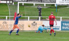Darren Lyon scores and team-mate David Galt celebrates. Picture by Jason Hedges
